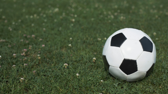A black and white soccer ball on turf