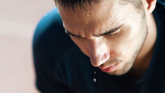 Man sweating because of high wet bulb globe temperature