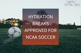 "A soccer field with a soccer ball on it and the text ""hydration breaks approved for NCAA soccer"""