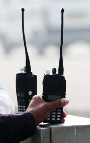 Hand reaching for two radios