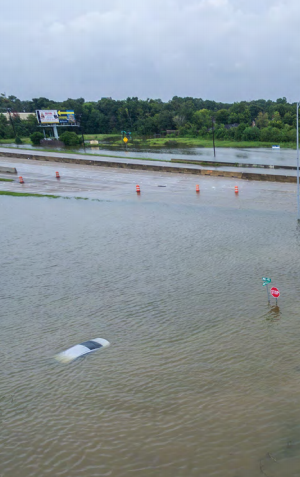 Flooded roadway with a car underwater