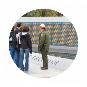 Park ranger showing guests around at a war memorial
