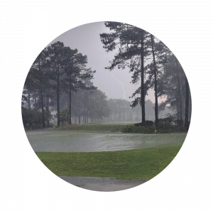 Torrential downpour with lightning strikes at a golf course