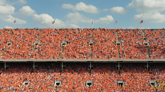 Packed upper levels of a college football stadium during a game