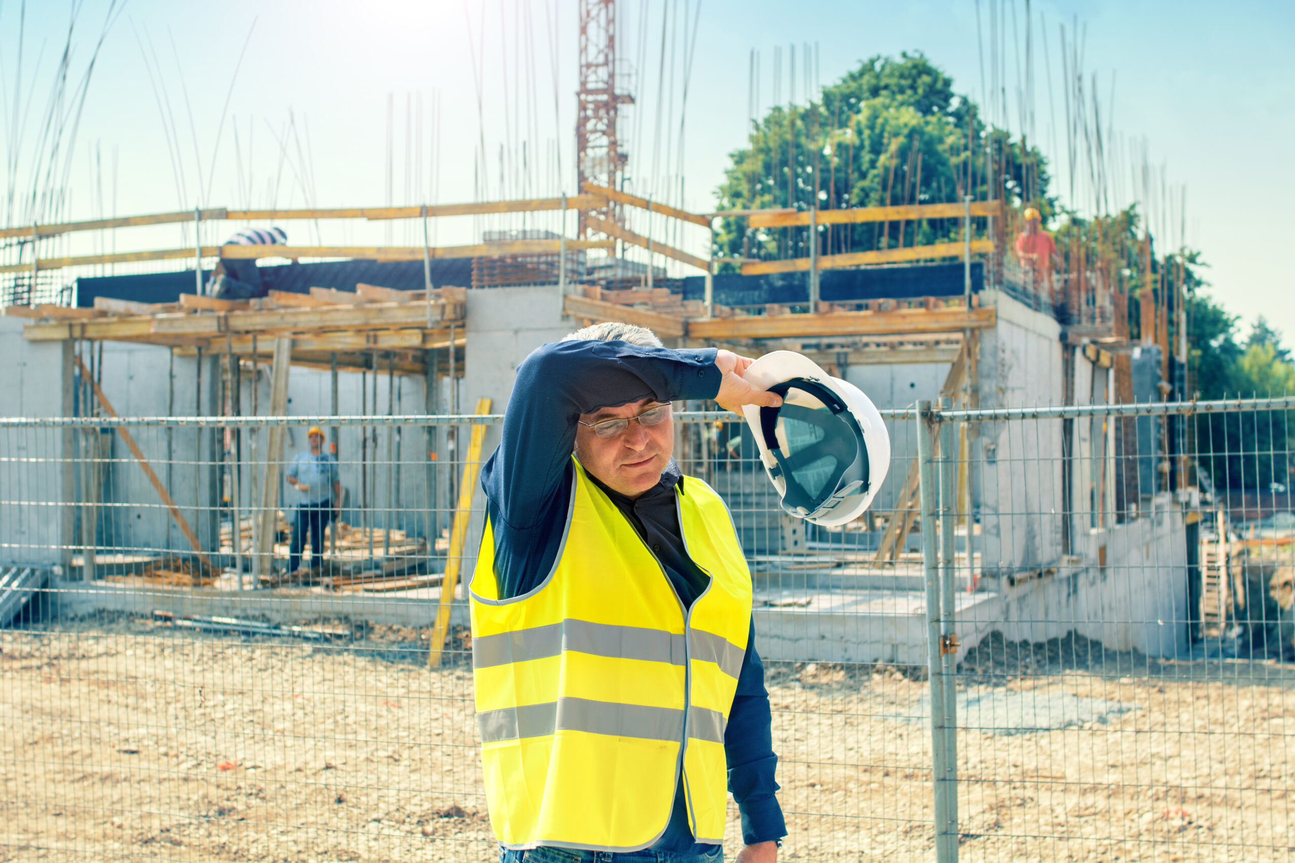 Construction Worker Suffering From Heat Stress